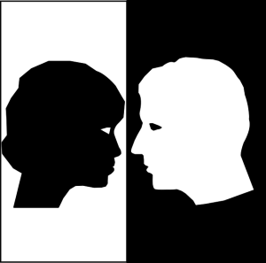 female black face on white background separated from male white face on black background
