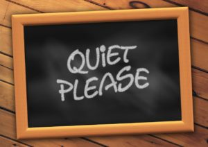 "chalk board stating ""quiet please"""