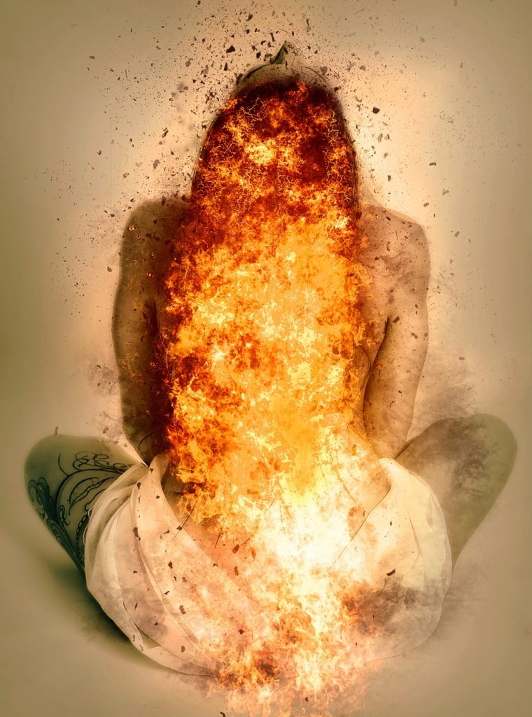 Sitting woman in ecstacy bursting in flames from within