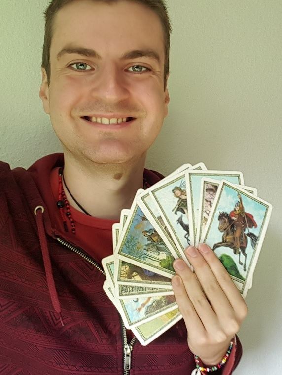 Gwydion Blackrose holding Tarot cards